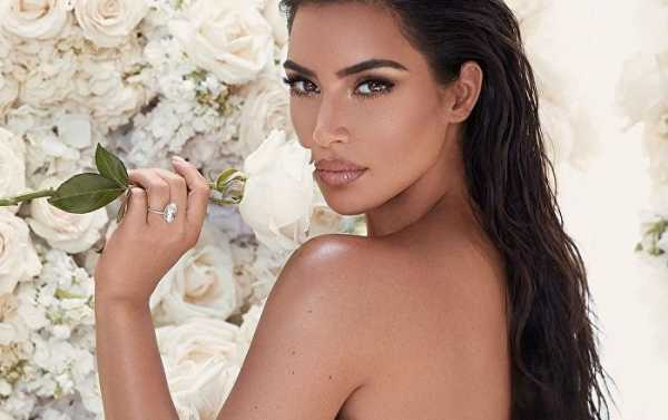 Kim Kardashian Shows Off Landmark Hourglass Figure in Her Brand-New Lingerie Promo Pics